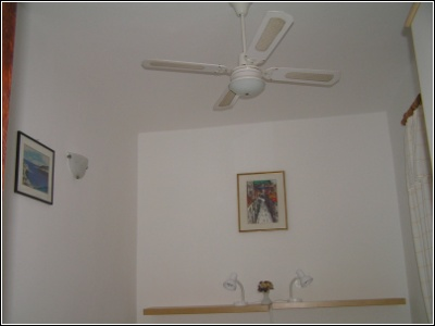 1B - ceiling fan directly above beds